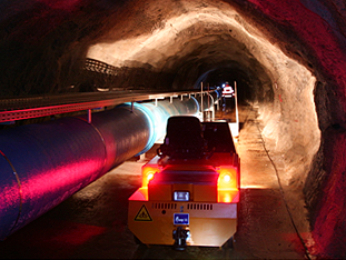 Underground – VOLK Electric Tow Tractor in the water tunnel